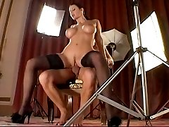 Busty brunette has sex in stockings and heels