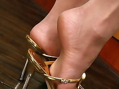 Heated blondie baring her perky tits and getting a taste of her nyloned feet
