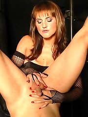 Beautiful mistress in corset and fishnets fucks her male slave upside down with a glass dildo