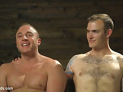 House dom, Master Christian Wilde, awaits on the rim chair, gazing down on the muscled slave...