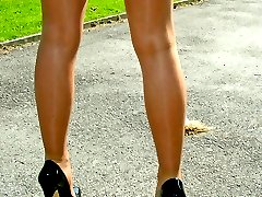 Gorgeous outdoor shoot with a very sexy blonde wearing high heels
