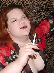 Hot busty BBW redhead smoking a cigarette