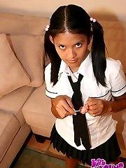 Cute Kat Young strips wearing a School Girl Uniform