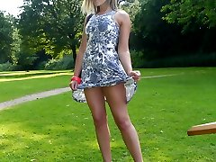 Blonde goddess Naomi is catching a rare bit of sunshine, and flashing her cheeky long legs in...