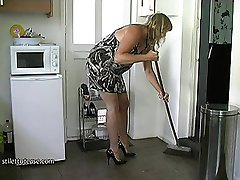 Bare legged Maid Melinda does the housework in her high heels while you take a look at her sexy...
