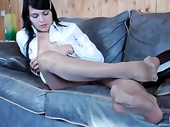 Lewd business-lady in silky hose going for pussy-stroking and feet-fondling