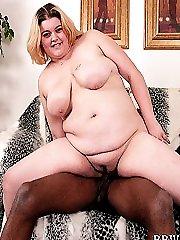 Cute chubby blonde riding hard black cock