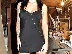 Tattooed brunette exgirlfriend Alya Grey strips black dress and shows sexy tits at the wall
