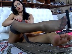 Naked chick spreads her bare toes before covering her feet with sleek nylon