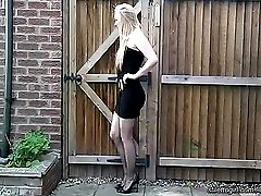 Toni wears elegant high heeled shoes on her patio. As she takes her foot in and out, her heel...