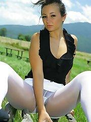 Breathtaking brunette in black top, white miniskirt and white pantyhose.