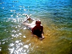 Two skinny nudist teens frolic around the beach