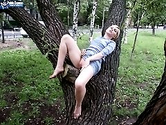 Lying naked on a tree with public attention