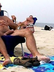 Nude men Sunbathe on the beach