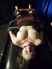 Smutty meets a bondage virgin and introduces her to some powerful restrain bondage. Smutty gets her without bra and beings to lock her down to a table with leather cuffs, belts, and chains.