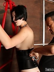 Master Nik Satanas gives Sula a very expert lashing. Starting with a super hot up, he proceeds to use a flogger made of chain, back to leather, then moves on to a single tail whip. Sula takes it so well, you see some real life aftercare in this serious bondage sequence.