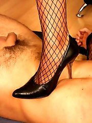 Fascinating prurient bitches in stockings torturing their obedient slave