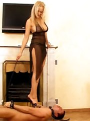 Hot busty mistress takes a walk over her pathetic slaves unprotected body