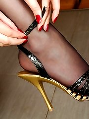 Dazzling babe enjoying the feel of her silky black hose on her yummy feet