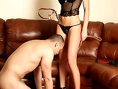 Submissive muscleman earns his mistress's mercy by giving her smooth holes a good skillful licking