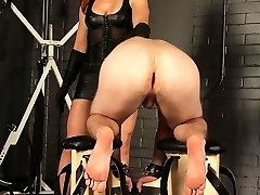 Catherine deSade makes a ladylike slave balance in a highly precarious posture. If he doesn't learn to take her spanks to his ass, and pain to his cock and plums, he'll fall right on his face.