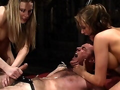 The stunning Harmony Rose and Tory Lane dual team insane bill in this week?s full throttle punishing meninpain. They fuck his ass and gullet until he begs for them to stop but that?s just a warm up. After getting him to ride the sybian with a vibrating attachment in his ass, the Women torture their sub by making him watch as the 2 pleasure each other while beating him. Finally the two steamy Doms take turns ravaging his fuck stick ball-gagged face and the strap-on that is covering his real penis. Once they are satisfied they jack his cum free and leave him bound and defenseless on the dungeon bed. This update starts at 100 mph and goes from there!