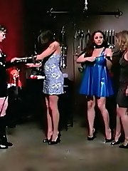 Two ruthless dommes bind 2 submissive babes and keep them in bondage