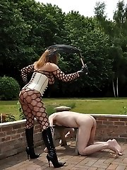 After failing to impress Mistress Carly with his cock, she then wraps her pathetic slave in cling film and squeezes his cock with her leather boot and then rides him hard