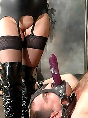 Chubby mistress fucks cuffed slave`s ass with a glass toy and rides his facial strapon