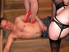 Two Mistresses trampling a man