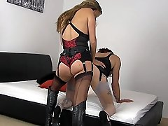 Femdom Jane is feeling very fiery today, and has this little slut bent over her bed with her...