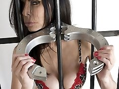 Ashley Renee is caged and bound by leather bondage straps. The damsel in distress fights against...