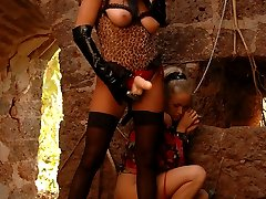 Mistress in stockings and latex cat mask strapon fucks submissive blonde in a ruined tower