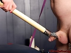Dominatrix Cheyenne leads slave will in by a chain around his penis. She then cords him into a swaying bed and commences his torture for the day. Cheyenne whips, paddles, and canes his chisel to get him heated up. The more anguish she inflicts, the harder will's meatpipe gets. Cheyenne gets creative and pulls out a pair of boxing gloves and punches him over and over in his shaft and balls. Just when will thinks it's all over, she has one final trick up her sleeve. Cheyenne grabs anything she can find that is acute, scratchy, and spiked. She leaves him with a obese pony brush with his pink cigar shoved through the middle of it.