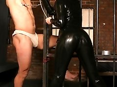 Sexy mistress Anastasia Pierce bounds her slave and punishes him with nipple clamps