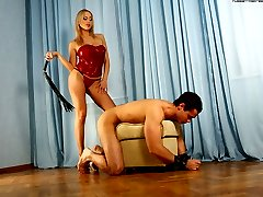 Slave gets gagged and whipped before being allowed to lick domina's soles