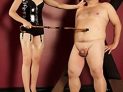 Domina O warms up her marionette with some flogging, and then binds up his cock and balls.  Next Mistress O takes a large whip to his cock and balls and puts a rat trap on his fuck-stick.  To really scare her gimp, Mistress O pulls out a burdizzo castration device and threats to eliminate his jizz-shotgun permanently.