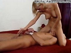Busty ash-blonde domina gives her slave a crazy hardcore handjob while facesitting him with no mercy
