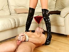 Beautiful brunette forcing her obedient curly-headed slave to cootchie eating