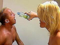 Blond Mistress Petra and pee gimp