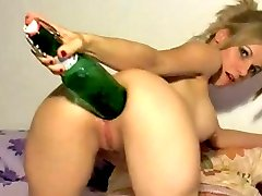 Hot young slut fucking her asshole with a giant beer bottle