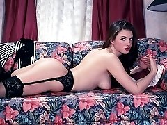 Smooth and seductive chick flaunting unshaved twat on the couch