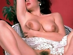 Hot solo scene with a stunning porn model posing in the nude to show off her hairy twat