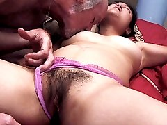 Sexy mature Asian with a thick bush guzzling a big dick before welcoming it in her gash