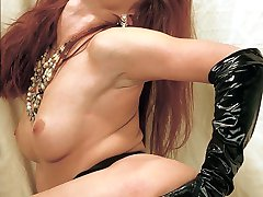 Pretty redhead posing in her bedroom and reaches between her legs to examine her hirsute cooze
