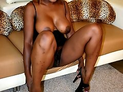 Ebony chick Coco Pink welcomes in a hard dick in her hairy pussy after giving a sinful blowjob