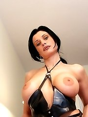 See this steamy big tit latex brunette