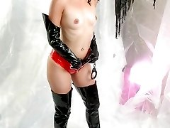 Posing in latex boots