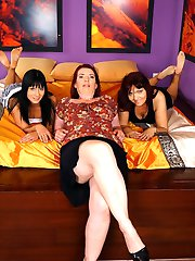 Three old and young lesbians make out on the bed
