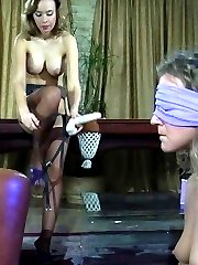 Blindfolded chick gags on a fat strap-on cock before intense all-girl anal
